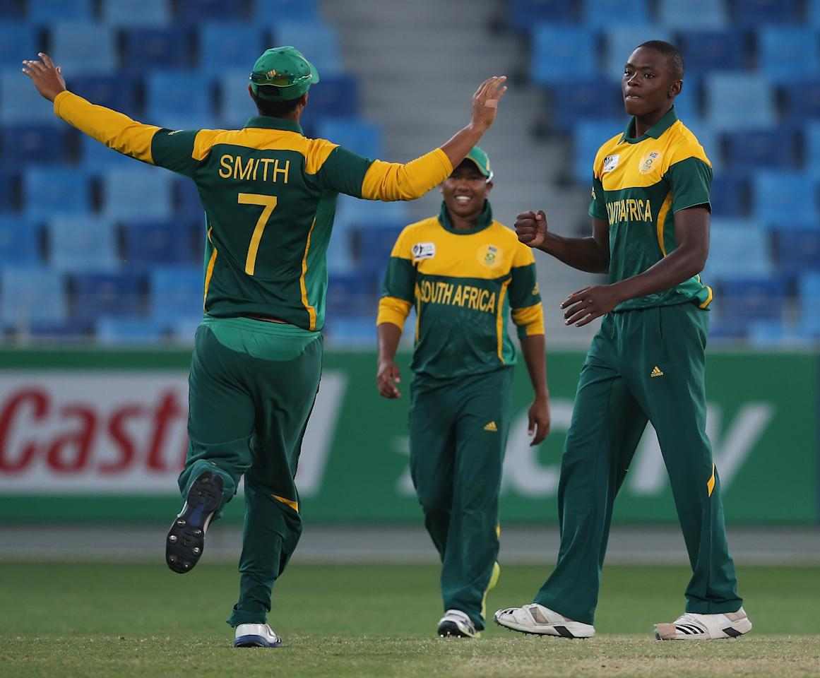 DUBAI, UNITED ARAB EMIRATES - FEBRUARY 26:  Kagiso Rabada and Joson Smith of South Africa celebrate after winning  the ICC U19 Cricket World Cup 2014 Semi Final match between South Africa and Australia at the Dubai Sports City Cricket Stadium on February 26, 2014 in Dubai, United Arab Emirates.  (Photo by Francois Nel - IDI/IDI via Getty Images)