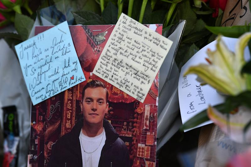 Floral tributes and photographs of the first victim to be named, Jack Merritt, are pictured close to London Bridge. Source: Getty Images