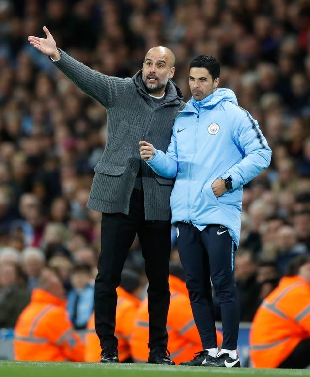 Guardiola (left) and Arteta (right) enjoyed considerable success together at City