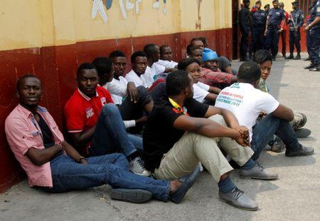 Congolese police detain protestors demanding that President Joseph Kabila leave power by the end of the year in Kinshasa