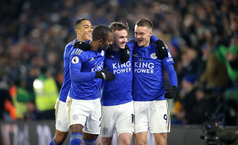LEICESTER, ENGLAND - DECEMBER 04: Jamie Vardy of Leicester City celebrates with Ricardo Pereira of Leicester City, James Maddison of Leicester City and Youri Tielemans of Leicester City after scoring from the penalty spot to make it 1-0 during the Premier League match between Leicester City and Watford at The King Power Stadium on December 4, 2019 in Leicester, United Kingdom. (Photo by Plumb Images/Leicester City FC via Getty Images)