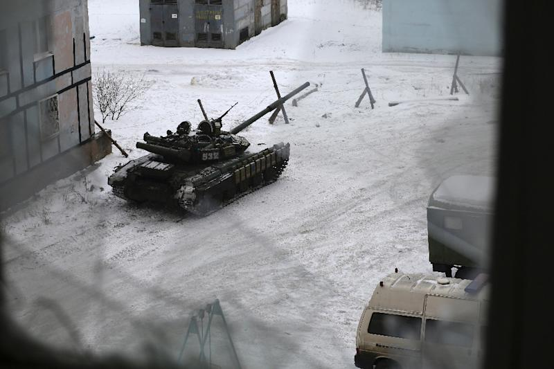 A tank from the Ukrainian Forces is stationed outside a building in the flashpoint eastern town of Avdiivka that sits just north of the pro-Russian rebels' de facto capital of Donetsk on February 2, 2017