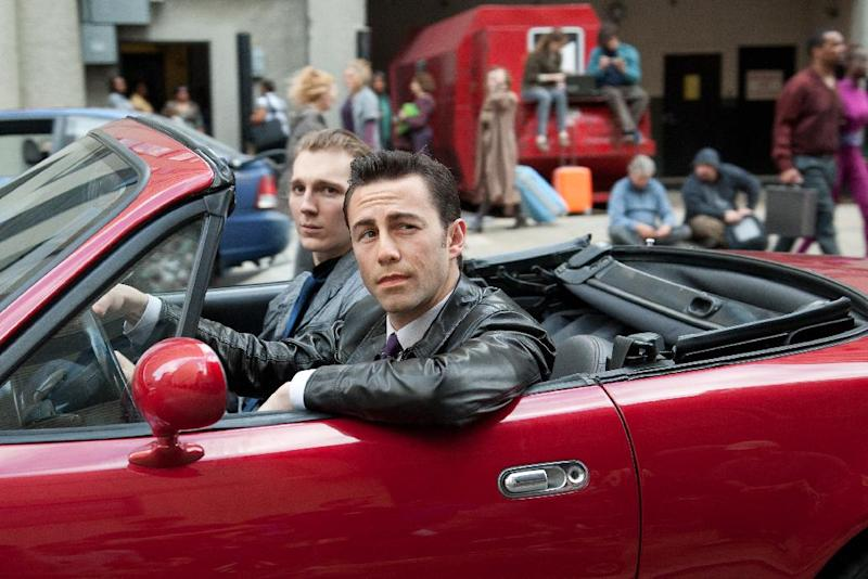 "This film image released by Sony Pictures shows Joseph Gordon-Levitt, foreground, and Paul Dano in a scene from the action thriller ""Looper."" For its 37th year, The Toronto International Film Festival opens with a big Hollywood action film, the sci-fi tale ""Looper,"" starring Bruce Willis, Joseph Gordon-Levitt and Emily Blunt. (AP Photo/Sony Pictures Entertainment, Alan Markfield)"