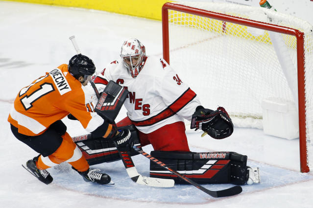 Philadelphia Flyers' Travis Konecny, left, cannot get a shot past Carolina Hurricanes' Petr Mrazek during the second period of an NHL hockey game, Tuesday, Nov. 5, 2019, in Philadelphia. (AP Photo/Matt Slocum)