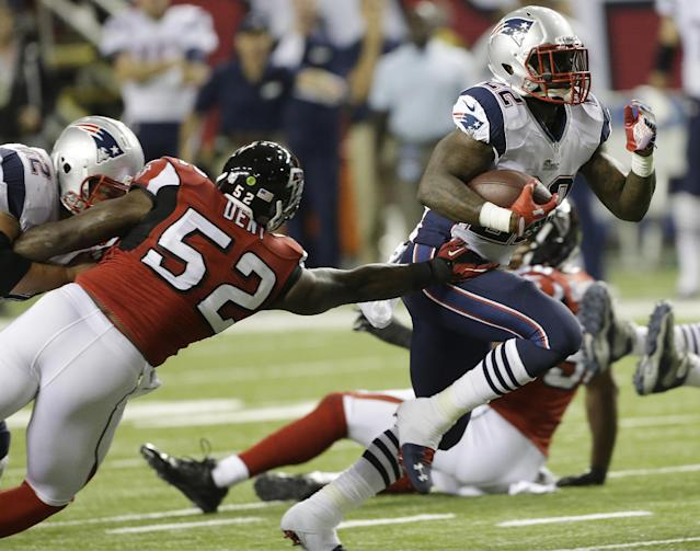 New England Patriots running back Stevan Ridley (22) moves the ball against Atlanta Falcons middle linebacker Akeem Dent (52) during the first half of an NFL football game, Sunday, Sept. 29, 2013, in Atlanta. (AP Photo/John Bazemore)