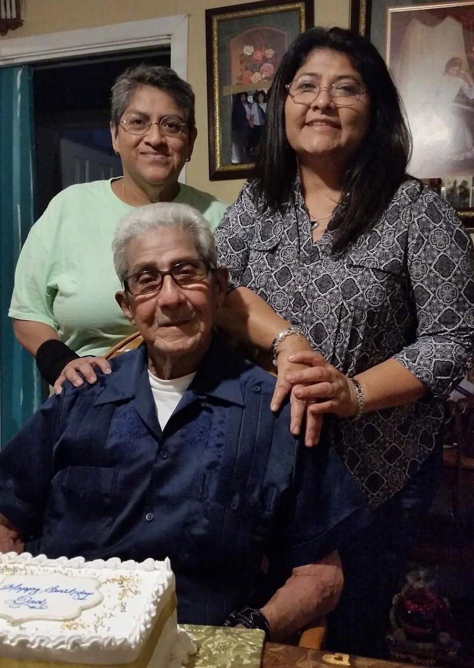 Guadalupe Ramirez (back left) with her partner Diane Muniz and her late father, Celedonio Ramirez. Guadalupe, who was at high risk for serious COVID-19, received monoclonal antibodies after her positive diagnosis in January 2021.