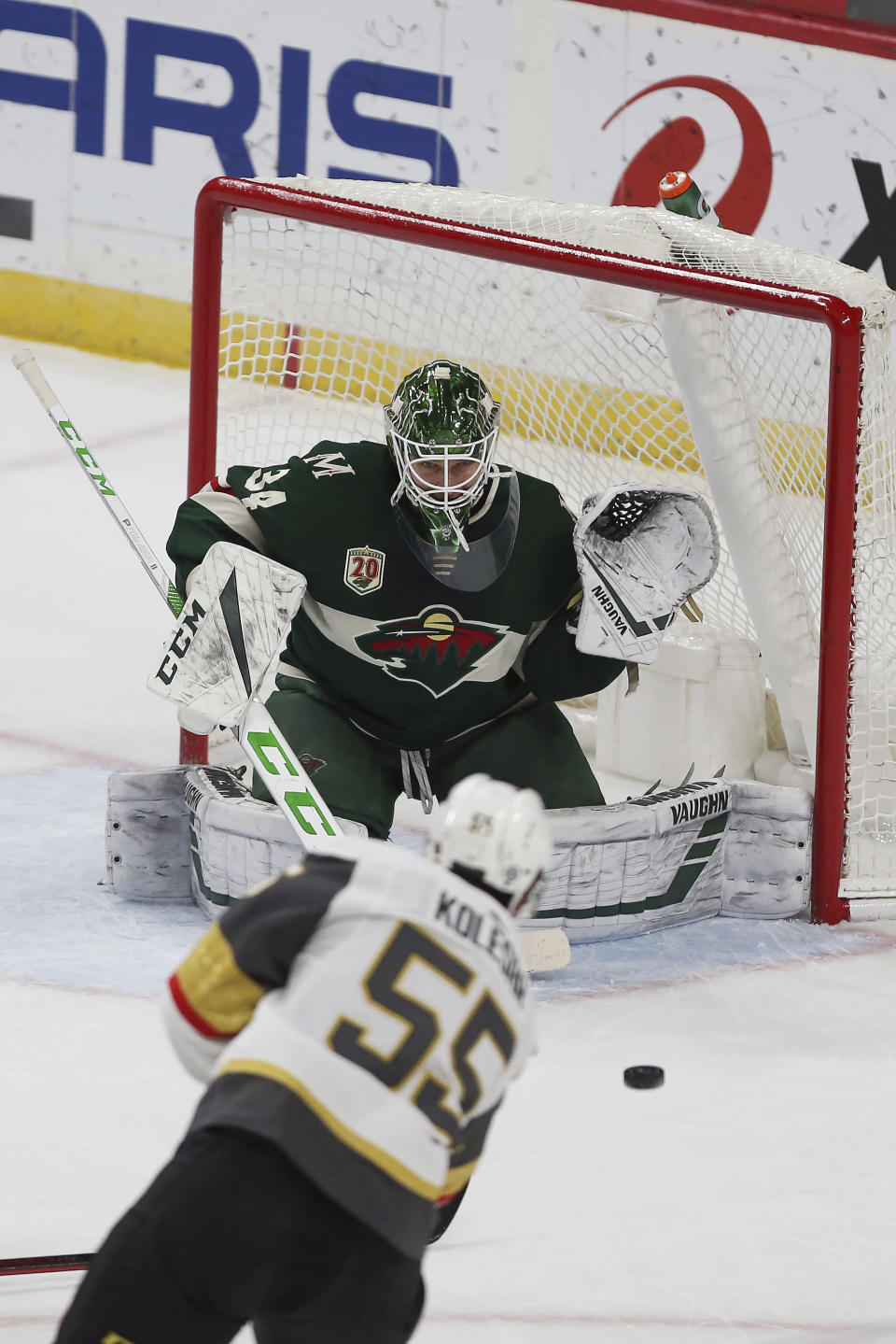 Minnesota Wild goalie Kaapo Kahkonen (34) gets ready for the puck shot by Vegas Golden Knights' Keegan Kolesar (55) in the first period of an NHL hockey game, Monday, March 8, 2021, in St. Paul, Minn. (AP Photo/Stacy Bengs)