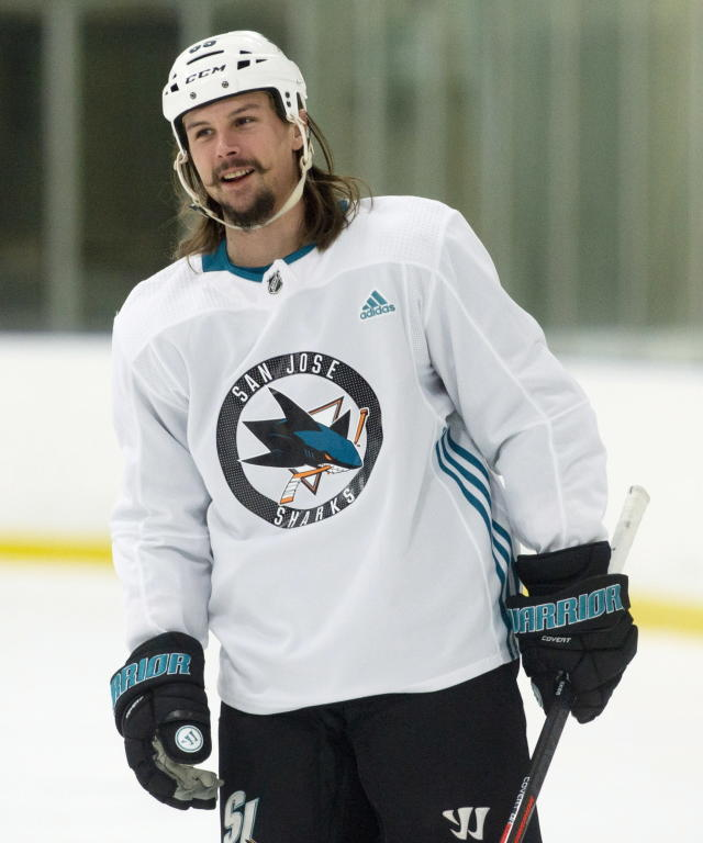 FILE - In this Nov. 30, 2018, file photo, San Jose Sharks' Erik Karlsson smiles as he skates during practice in Ottawa. Karlsson is one of several players who could've probably cashed out even richer contracts by going to free agency and opted instead to re-sign with their current teams. (Adrian Wyld/The Canadian Press via AP, File)