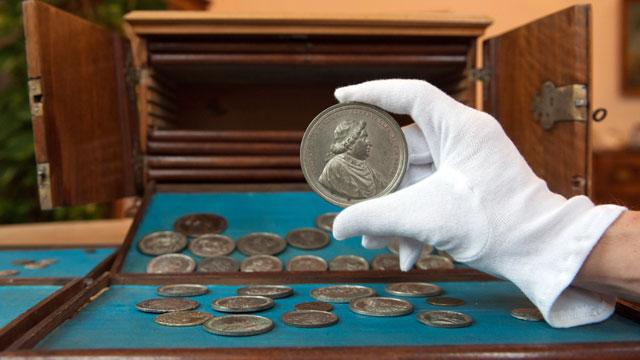 Forgotten Treasure: Library Janitor Discovers Silver Coin Cache