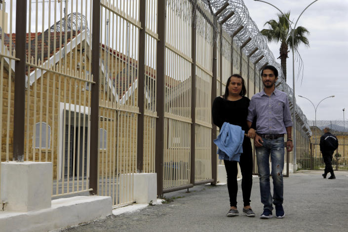 Cypriot Kevork Tontian, right, and Brazilian Wemson Gabral da Costa walk together inside Cyprus' prison in the capital Nicosia, Cyprus, Thursday, Jan. 16, 2020. According to Prison authorities, Tontian and Da Costa are only the second same-sex couple to tie the knot inside a correctional facility of a European Union member country. Former heroin addict Kevork Tontian says he met the man he wanted to spend the rest of his life with behind bars, and not even his freedom was enough to keep him away from Wemson Gabral da Costa. (AP Photo/Petros Karadjias)