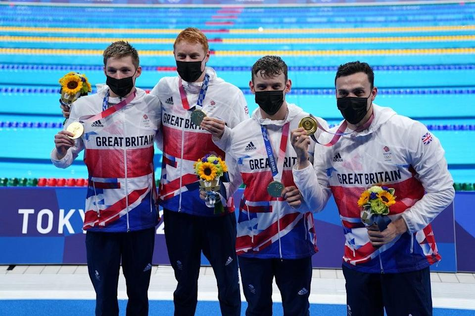 Duncan Scott, Tom Dean, Matthew Richards and James Guy after securing relay gold (Adam Davy/PA)