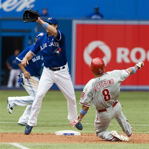 Philadelphia Phillies' Shane Victorino steals second against the Toronto Blue Jays during the fourth inning of a baseball game, Sunday, June 17, 2012, in Toronto. (AP Photo/The Canadian Press, Aaron Vincent Elkaim)