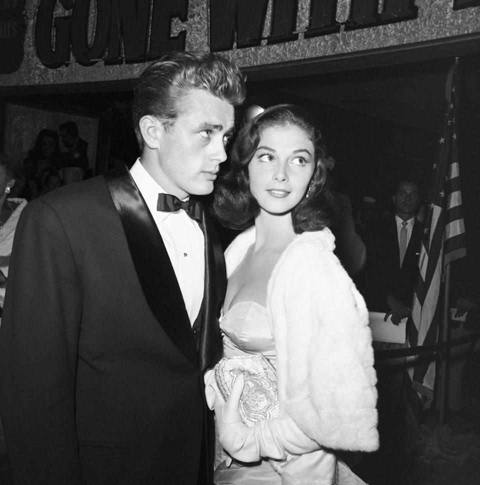 <p><em>Rebel Without a Cause</em> actor James Dean poses next to Italian actress Pier Angeli at an event in 1954. </p>