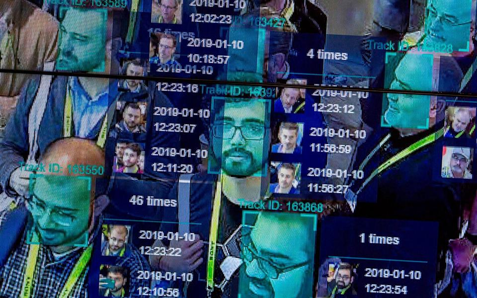The technology works by using artificial intelligence to scan faces and cross-reference them with a database of people's pictures - David McNew/AFP/Getty Images