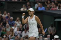 Australia's Ashleigh Barty celebrates after defeating compatriot Ajla Tomljanovic during the women's singles quarterfinals match on day eight of the Wimbledon Tennis Championships in London, Tuesday, July 6, 2021. (AP Photo/Kirsty Wigglesworth)