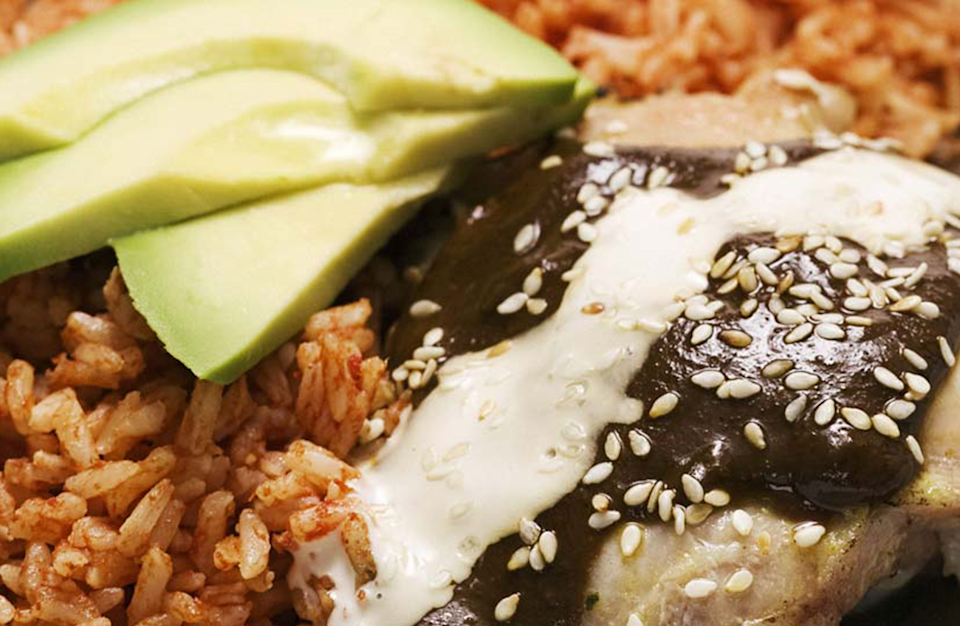 """<p>A sauce for anything from enchiladas and tacos to shrimp or chicken, mole may seem like a Mexican mystery sauce. Admittedly, its contents are cause to scratch your head: chiles, tomatoes, sesame seeds, lots of peanut butter, raisins and much more. But mole just works.</p> <p><strong><a href=""""https://www.thedailymeal.com/recipes/easy-mole-sauce-recipe-0?referrer=yahoo&category=beauty_food&include_utm=1&utm_medium=referral&utm_source=yahoo&utm_campaign=feed"""" rel=""""nofollow noopener"""" target=""""_blank"""" data-ylk=""""slk:For the Mole Sauce recipe, click here."""" class=""""link rapid-noclick-resp"""">For the Mole Sauce recipe, click here.</a> </strong></p>"""