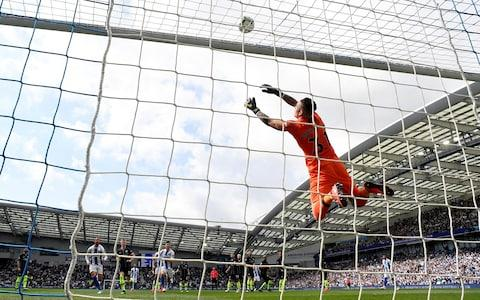 Manchester City's Ederson saves a shot from Brighton's Lewis Dunk - Credit: REUTERS