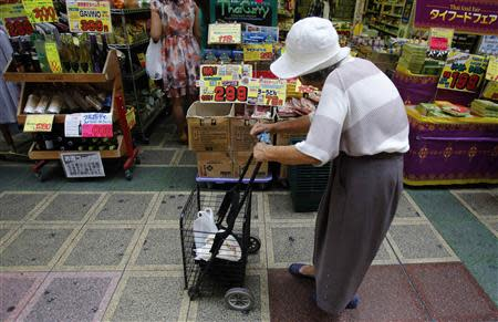 File photo shows a woman looking at items at a local shopping street in Tokyo