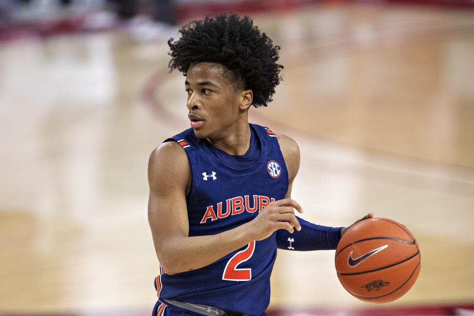 Sharife Cooper #2 of the Auburn Tigers runs the offense during a game against the Arkansas Razorbacks at Bud Walton Arena on January 20, 2021 in Fayetteville, Arkansas. The Razorbacks defeated the Tigers 75-73.  (Photo by Wesley Hitt/Getty Images)