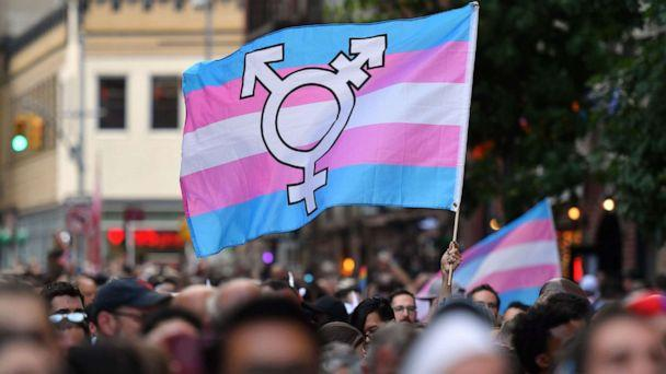 PHOTO: A person holds a transgender pride flag as people gather on Christopher Street outside the Stonewall Inn for a rally to mark the 50th anniversary of the Stonewall Riots in New York, June 28, 2019. (AFP via Getty Images, FILE)