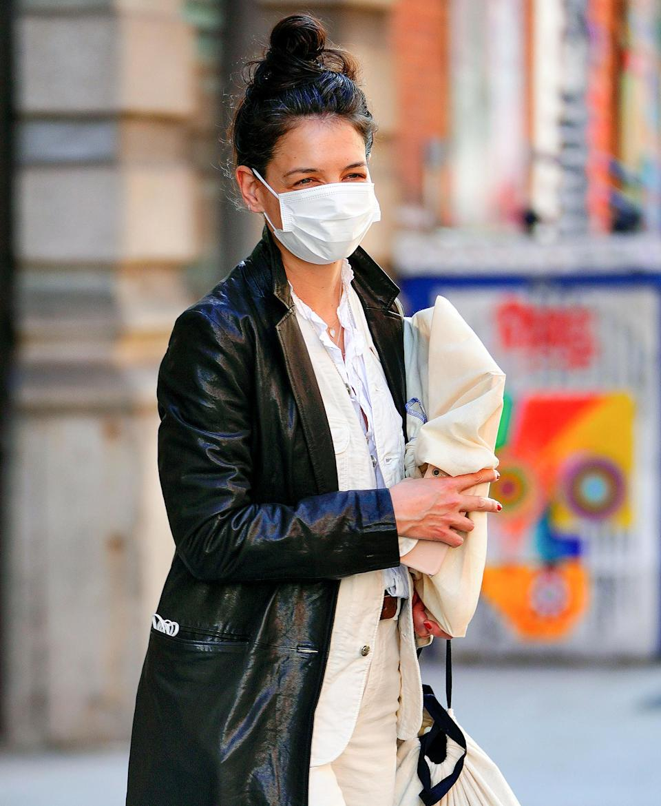 <p>Katie Holmes smiles from behind her mask on Thursday while out in New York City.</p>