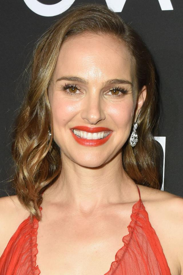 """<p>As Natalie Portman proves, an orange-red lipstick is a foolproof way to add warmth to your complexion and if you choose one with a glossy finish, such as Chanel's <a rel=""""nofollow"""" href=""""https://www.feelunique.com/p/CHANEL-ROUGE-COCO-SHINE-Hydrating-Colour-Lipshine-3g-coco-codes?"""">Rouge Coco Shine in Poppy Orange</a> or Mac's <a rel=""""nofollow"""" href=""""https://www.lookfantastic.com/mac-lipstick-various-shades/11471425.html?"""">Amplified Lipstick in Morange</a>, you will boost your skin's radiance too. </p>"""