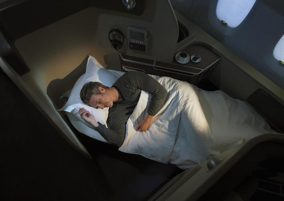 <p><span>Fly First Class with Qantas and your fully flat, extra-wide bed will feature a super sumptuous sheepskin mattress, as well plenty of pillows and cosy blankets. Just what you need after making the most of the fine wine, recommended by one of the Sommeliers in the Sky. [Photo: Qantas] </span> </p>