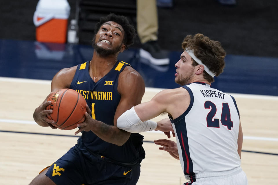 West Virginia's Derek Culver (1) goes to the basket against Gonzaga's Corey Kispert (24) during the first half of an NCAA college basketball game Wednesday, Dec. 2, 2020, in Indianapolis. (AP Photo/Darron Cummings)
