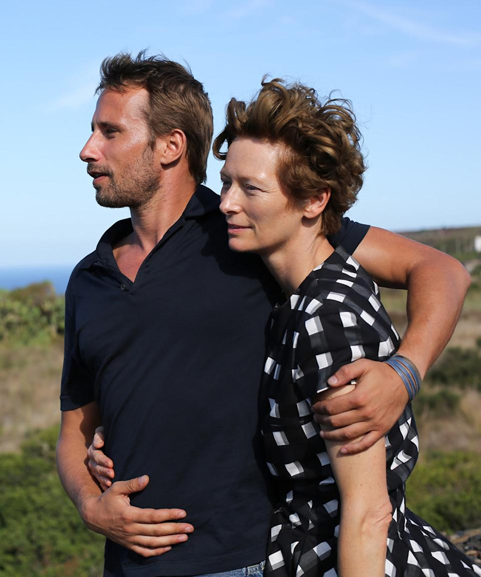 """<em><h2>A Bigger Splash (2016) </h2></em><br>Before Luca Guadagnino awed us with <em>Call Me By Your Name</em>, he created this equally endearing film starring his muse Tilda Swinton, Dakota Johnson, and Ralph Fiennes. At first glance, the location, a villa on the Mediterranean sea in Italy, would appear to be the shining star of the movie. But, in reality, it's the clothes that truly make it great. Swinton in silver sequins as a renowned pop star, Johnson wearing a perfectly damaged motorcycle jacket and cut-offs, linen, bikinis, sundresses, and more — if you're in need of a summer mood board, this is the film to watch. <br><span class=""""copyright"""">Photo: Moviestore/Shutterstock.</span>"""