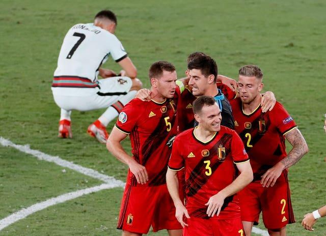 Belgium players celebrate winning 1-0 as Portugal's Cristiano Ronaldo reacts after the Euro 2020 game in Seville