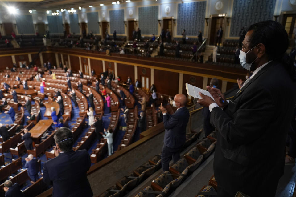 Member of Congress applaud as President Joe Biden speaks to a joint session of Congress Wednesday, April 28, 2021, in the House Chamber at the U.S. Capitol in Washington. (AP Photo/Andrew Harnik, Pool)