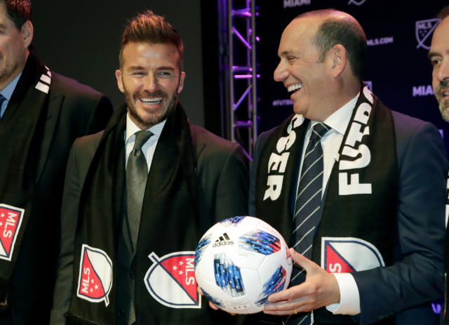 David Beckham, left, talks with Major League Soccer Commissioner Don Garber, right, at an event where it was announced that MLS is bringing an expansion team to Miami, Monday, Jan. 29, 2018, in Miami. The team is backed by Beckham and a group of investors. (AP Photo/Lynne Sladky)