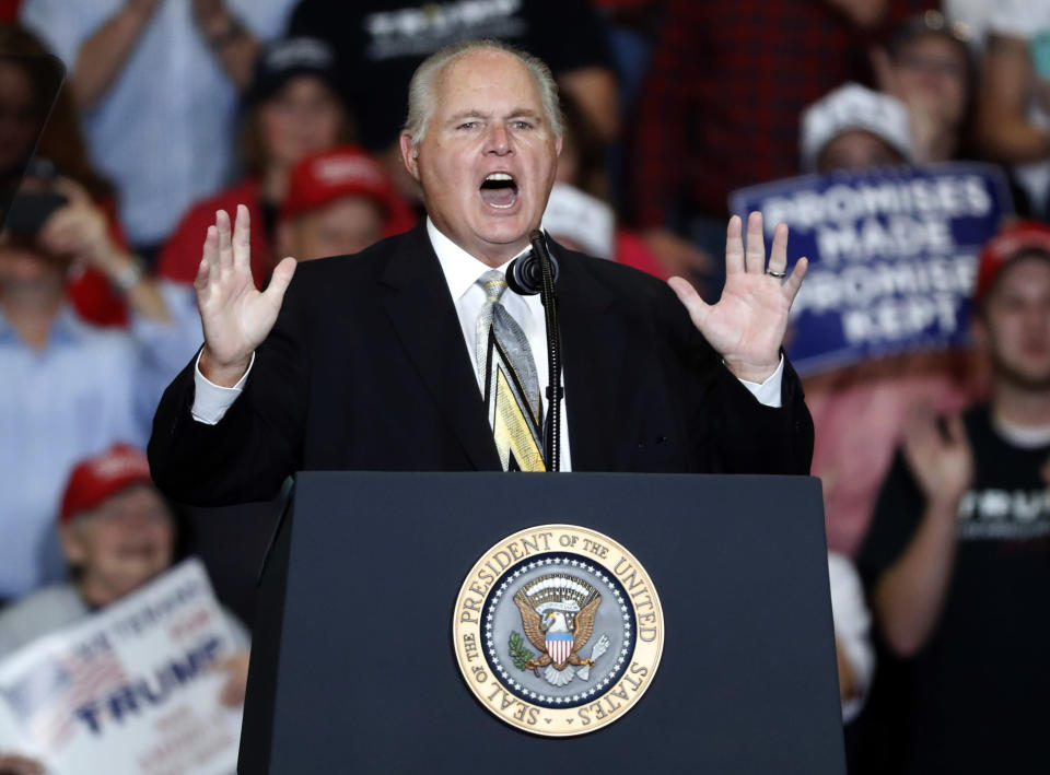 FILE - This Nov. 5, 2018 file photo shows radio personality Rush Limbaugh introducing President Donald Trump at the start of a campaign rally in Cape Girardeau, Mo. Limbaugh, the talk radio host who became the voice of American conservatism, has died. (AP Photo/Jeff Roberson, File)
