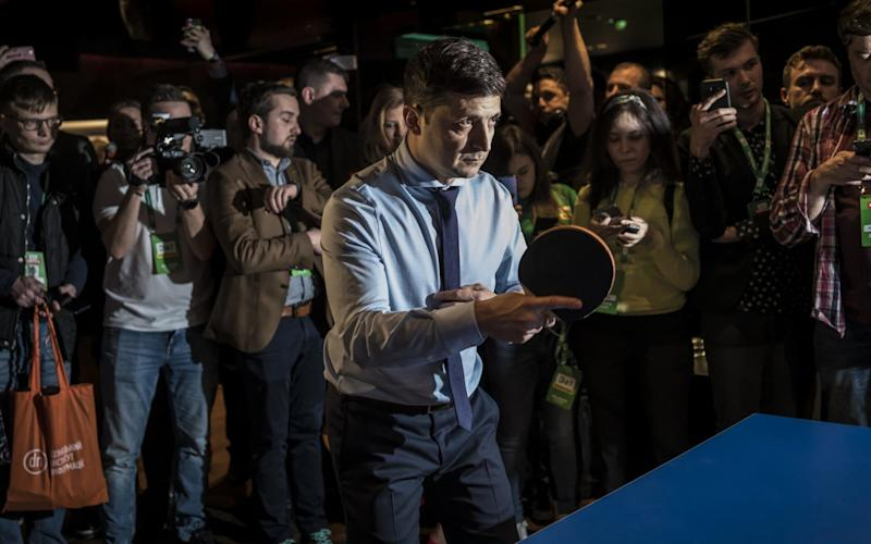 Volodymyr Zelenskiy, who won the first round, plays ping pong at his headquarters on Sunday evening - Getty Images Europe