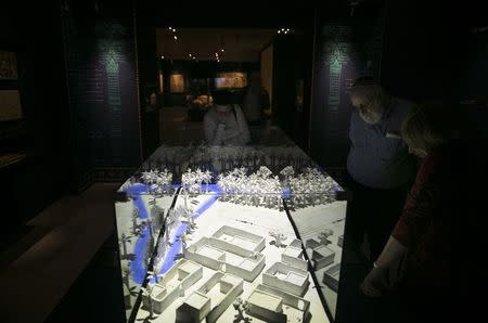 Visitors look at a model of a Jewish village from ancient Babylonia during an exhibition at the Bible Lands Museum in Jerusalem, February 3, 2015. REUTERS/Baz Ratner