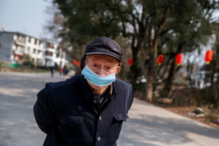Man wears a face mask in a village outside Donglin Temple that is under lockdown because of the coronavirus outbreak in Jiujiang