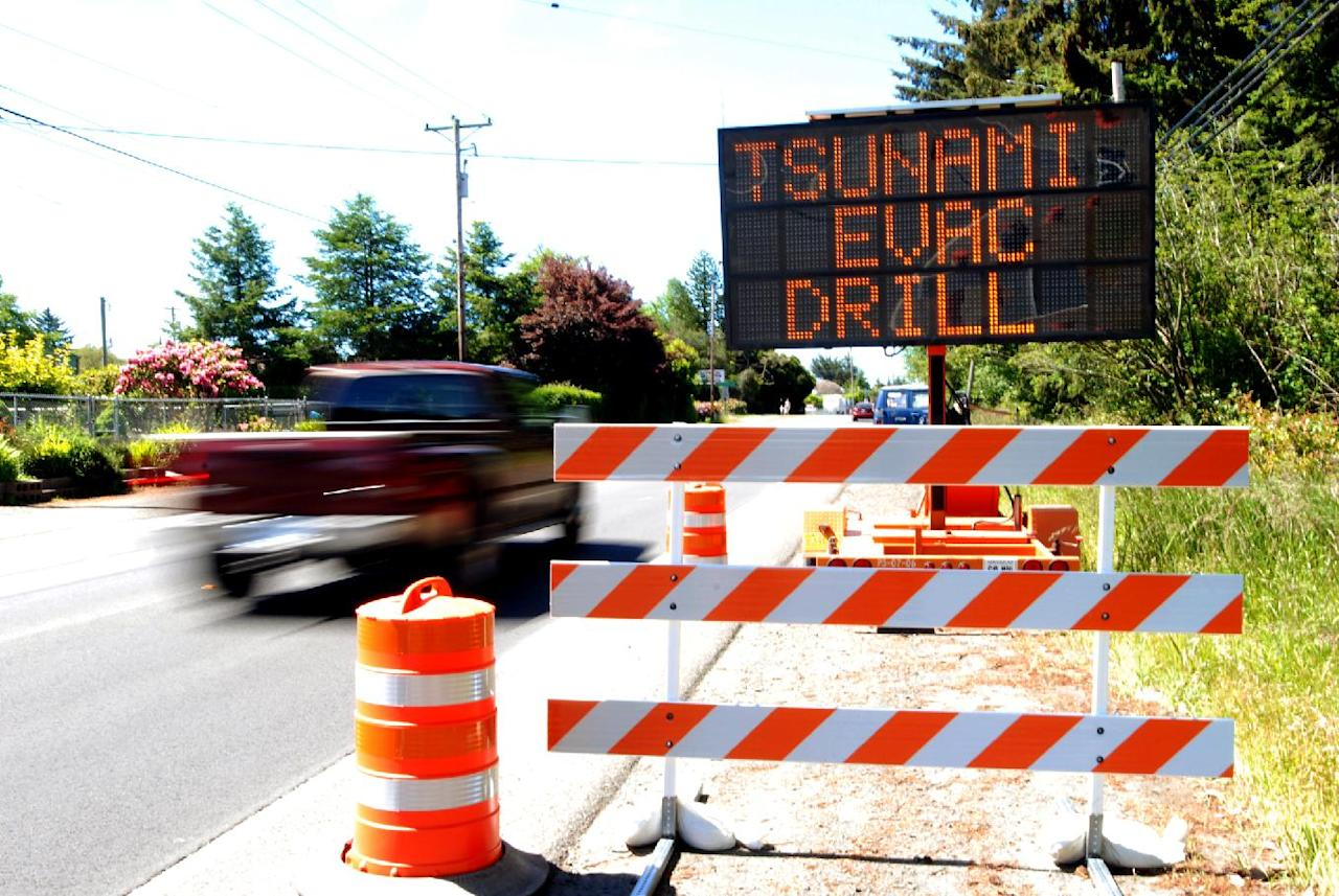 A sign advertises a tsunami evacuation drill Thursday, May 31, 2012 in Charleston, Ore. Thousands of people were expected to take part in the drill, the first for the coastal town. Authorities say last year's tsunami in Japan has raised awareness among people. (AP Photo/Jeff Barnard)