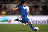 """FILE PHOTO: Argentine soccer great Diego Armando Maradona kicks the ball during a charity soccer match called """"Derby of the Heart"""" at the Olympic stadium in Rome"""