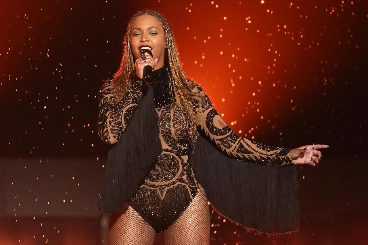 """FILE - In this June 26, 2016 file photo, Beyonce performs 'Freedom' at the BET Awards in Los Angeles. Beyonce and Adele are the top nominees at the MTV Video Music Awards, where their music videos will compete against Kanye West's controversial """"Famous"""" for video of the year. The VMAs will air live Aug. 28 from New York's Madison Square Garden. (Photo by Matt Sayles/Invision/AP, File)"""