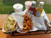 """<p>For nearly 40 years, Wagner's Drive-In has been serving some of <a href=""""https://www.thedailymeal.com/eat/guilty-pleasure-foods?referrer=yahoo&category=beauty_food&include_utm=1&utm_medium=referral&utm_source=yahoo&utm_campaign=feed"""" rel=""""nofollow noopener"""" target=""""_blank"""" data-ylk=""""slk:the best guilty-pleasure food"""" class=""""link rapid-noclick-resp"""">the best guilty-pleasure food</a> in the Twin Cities. Chili cheeseburgers, fried chicken and pork cutlet sandwiches are just some of the standout menu items. </p>"""