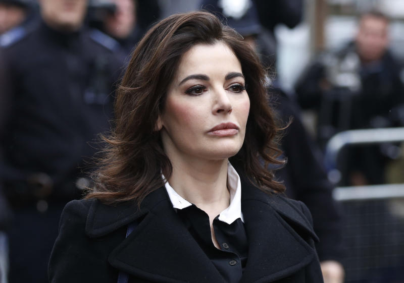 FILE - In this Wednesday, Dec. 4, 2013 file photo, celebrity chef, Nigella Lawson, arrives at Isleworth Crown Court in London. Two former assistants to Nigella Lawson and her former husband were acquitted of fraud Friday, Dec. 20, 2013 in London, capping a case where allegations of unauthorized spending on lavish goods were often overshadowed by titillating glimpses into the celebrity chef's troubled home life. (AP Photo/Sang Tan, File)
