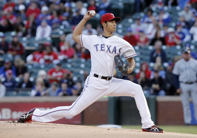 Texas Rangers starting pitcher Yu Darvish throws during the first inning of a baseball game against the Seattle Mariners, Wednesday, April 16, 2014, in Arlington, Texas. (AP Photo/Brandon Wade)