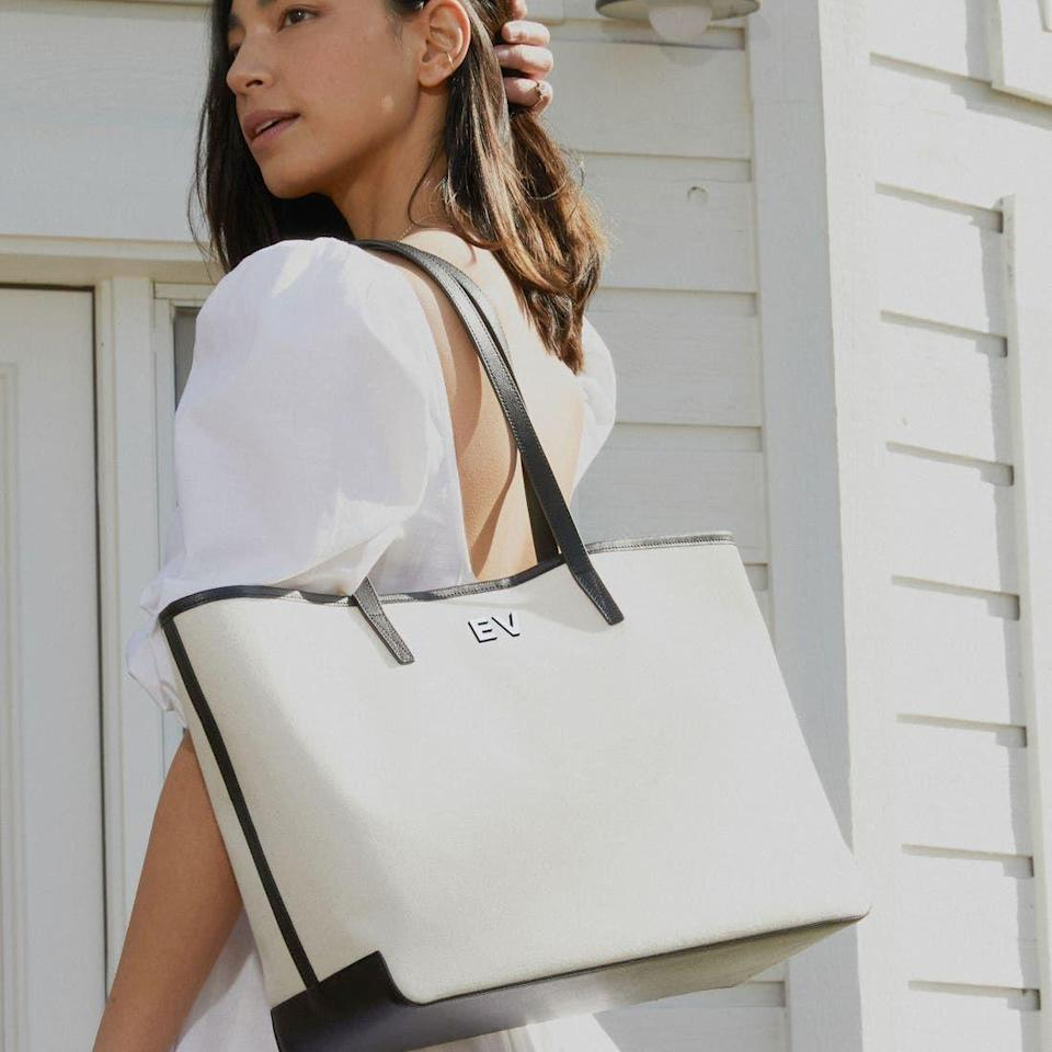 """<p>leatherology.com</p><p><strong>$150.00</strong></p><p><a href=""""https://www.leatherology.com/belmont-tote-in-canvas-natural-leather-natural-canvas-black/"""" rel=""""nofollow noopener"""" target=""""_blank"""" data-ylk=""""slk:Shop Now"""" class=""""link rapid-noclick-resp"""">Shop Now</a></p><p>Who doesn't <a href=""""https://www.townandcountrymag.com/style/fashion-trends/g3017/monogram-gift-ideas/"""" rel=""""nofollow noopener"""" target=""""_blank"""" data-ylk=""""slk:love a good monogram"""" class=""""link rapid-noclick-resp"""">love a good monogram</a>? Update her summer look with a canvas tote complete with her initials handpainted. She'll feel chic, that's for certain.</p>"""