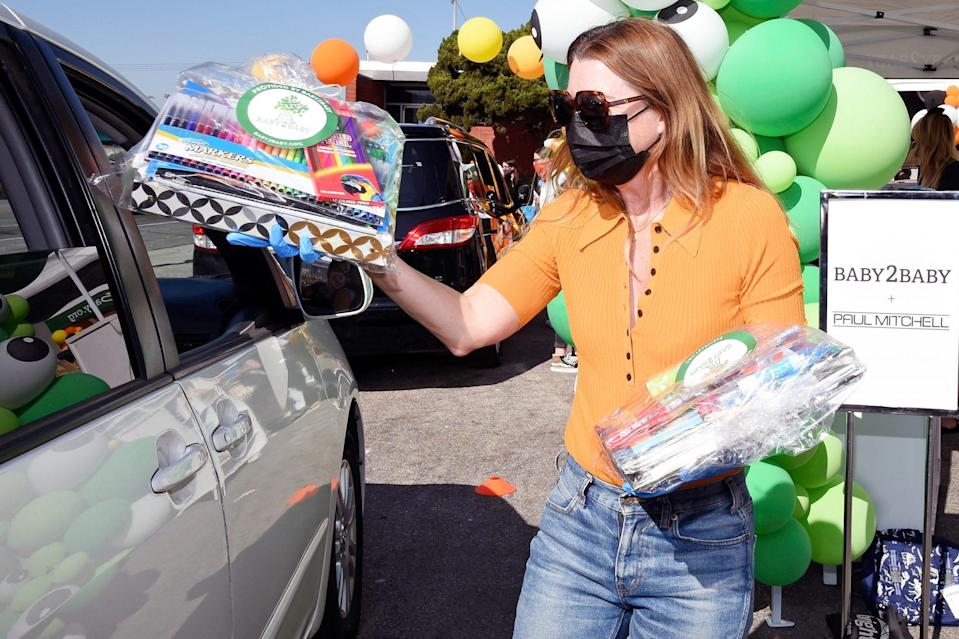 <p>Ellen Pompeo hands out supplies at Baby2Baby's Halloween Drive-Thru Distribution presented by Paul Mitchell on Friday in L.A. </p>