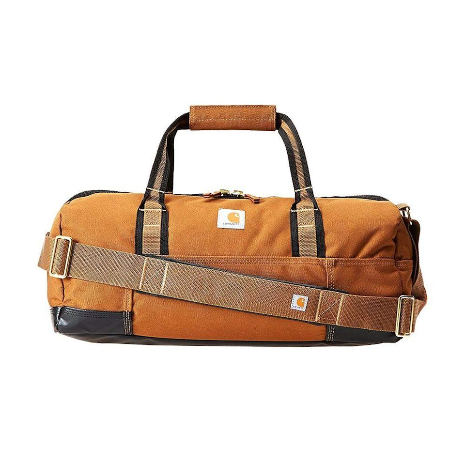 """<p><strong>Carhartt</strong></p><p>amazon.com</p><p><strong>$53.00</strong></p><p><a href=""""https://www.amazon.com/dp/B00ES8KVNQ?tag=syn-yahoo-20&ascsubtag=%5Bartid%7C2089.g.34239500%5Bsrc%7Cyahoo-us"""" rel=""""nofollow noopener"""" target=""""_blank"""" data-ylk=""""slk:Shop Now"""" class=""""link rapid-noclick-resp"""">Shop Now</a></p><p>This rugged Carhartt bag is tough enough to take camping but still stylish and functional enough for everyday use. The brand may be better known for its durable outerwear, but its Legacy Gear Bag is equally as reliable with a water-repellent fabric exterior and an abrasion-resistant base. </p>"""