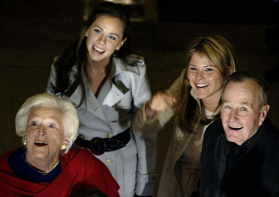 George H.W. andBarbara Bush wave with their granddaughters Barbara (center left) and Jenna, as they walk through the Capitol Hill Rotunda onJan. 20, 2005.