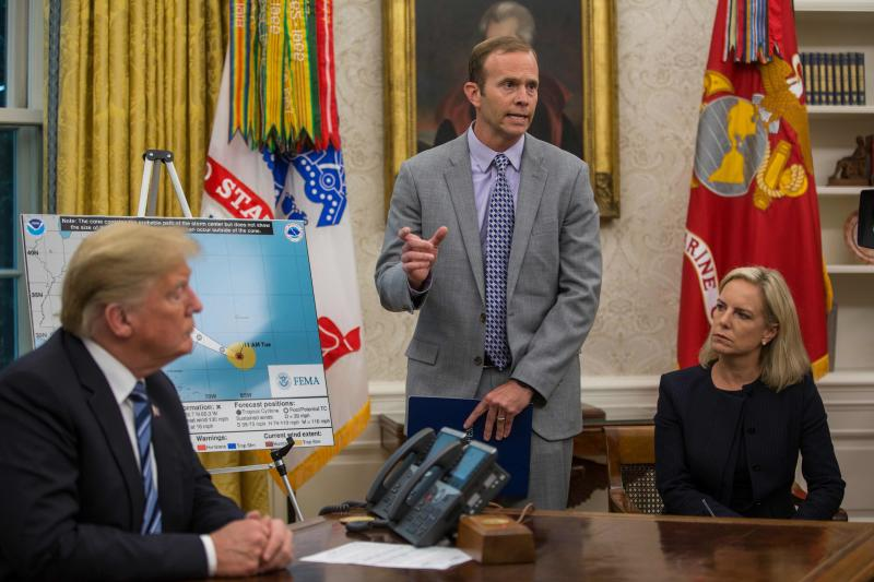 FEMA Administrator Brock Long, center, speaks to members of the media after briefing President Donald Trump on Hurricane Florence in the Oval Office at the White House Sept. 11, 2018 in Washington.