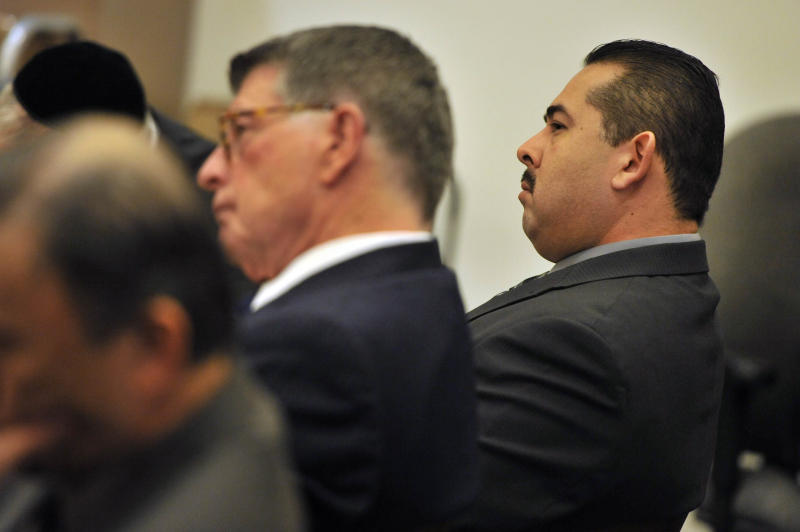 Former Fullerton police officer Manuel Ramos listens to Orange County district attorney Tony Rackauckas' closing argument in the case against Ramos and fellow former officer Jay Cicinelli in Santa Ana, Calif. Cicinelli and Ramos pleaded not guilty in the beating death of Kelly Thomas, 37, a mentally ill homeless man. Thomas died five days after a violent struggle with officers who were responding to a report of a man breaking into cars at a transit hub. (AP Photo/The Orange County Register, Joshua Sudock, Pool)