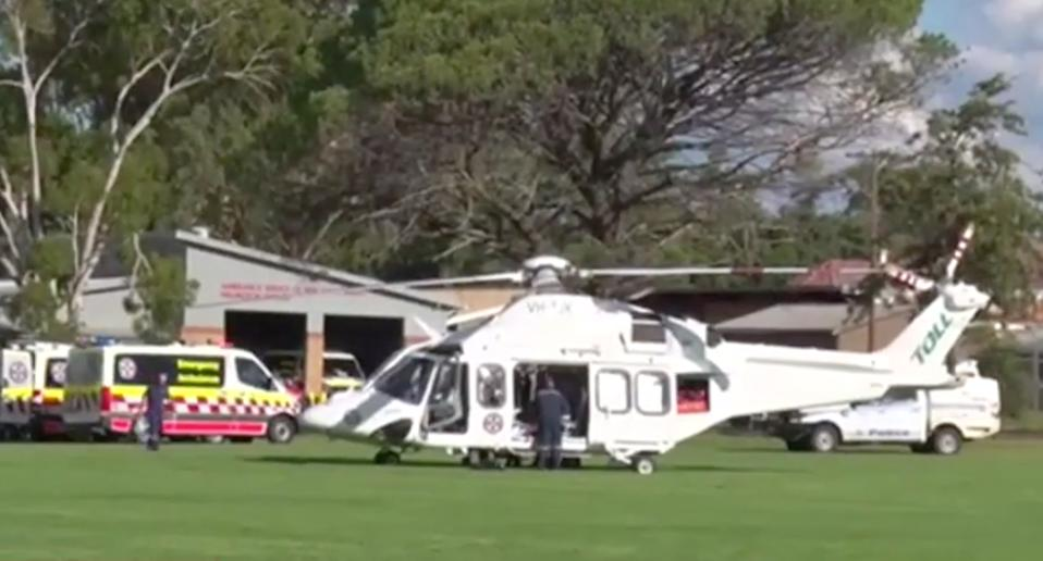 A helicopter lands next to an ambulance in Wellington, NSW.