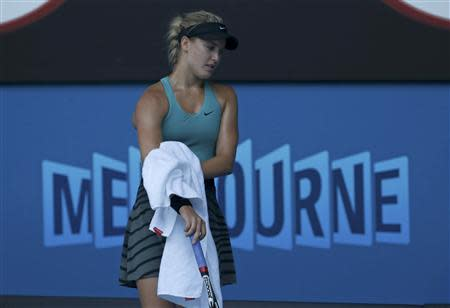 Eugenie Bouchard of Canada wipes her arms in between points during her women's singles semi-final match against Li Na of China at the Australian Open 2014 tennis tournament in Melbourne January 23, 2014. REUTERS/Bobby Yip